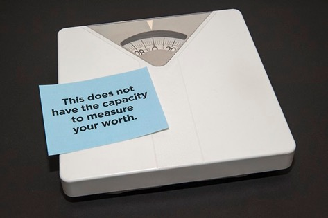 """A scale with a note on top that says """"This does not have the capacity to measure your worth."""""""