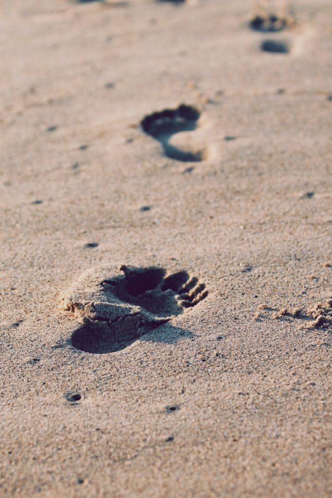 Foot prints on sand.