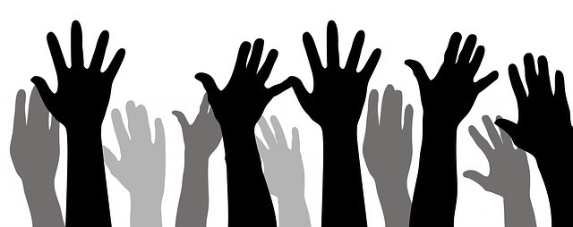 Silhouette of multiple hands.