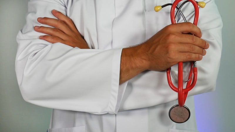 A medical professional holding a stethoscope.