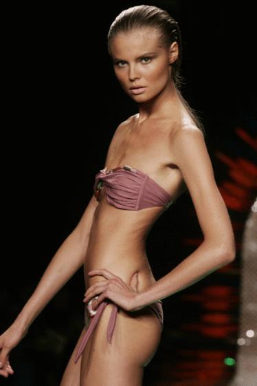 A thin model wearing a bikini.