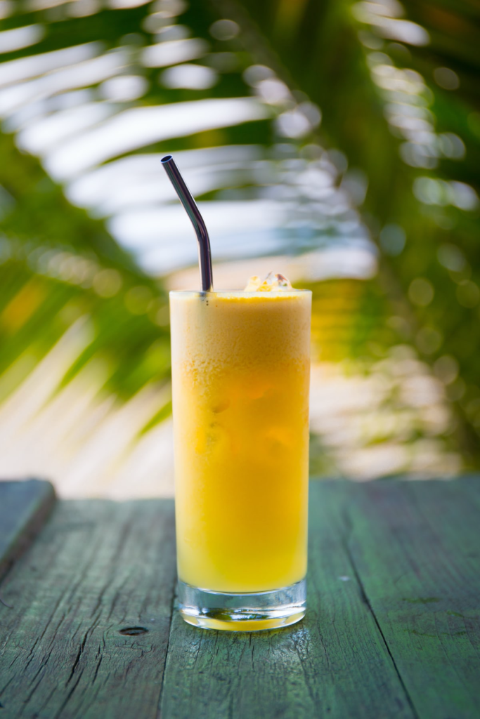 A glass of pineapple juice.