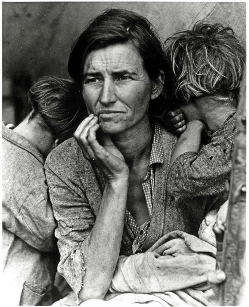A person with two kids on their side. The person looks distressed.