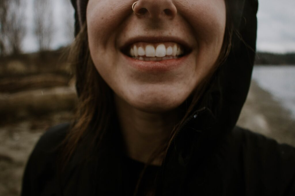 A person smiling with their teeth.
