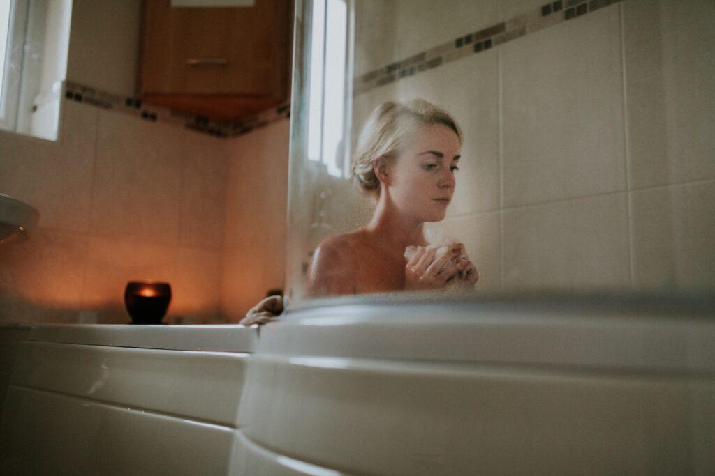 A person sitting in a bathtub.