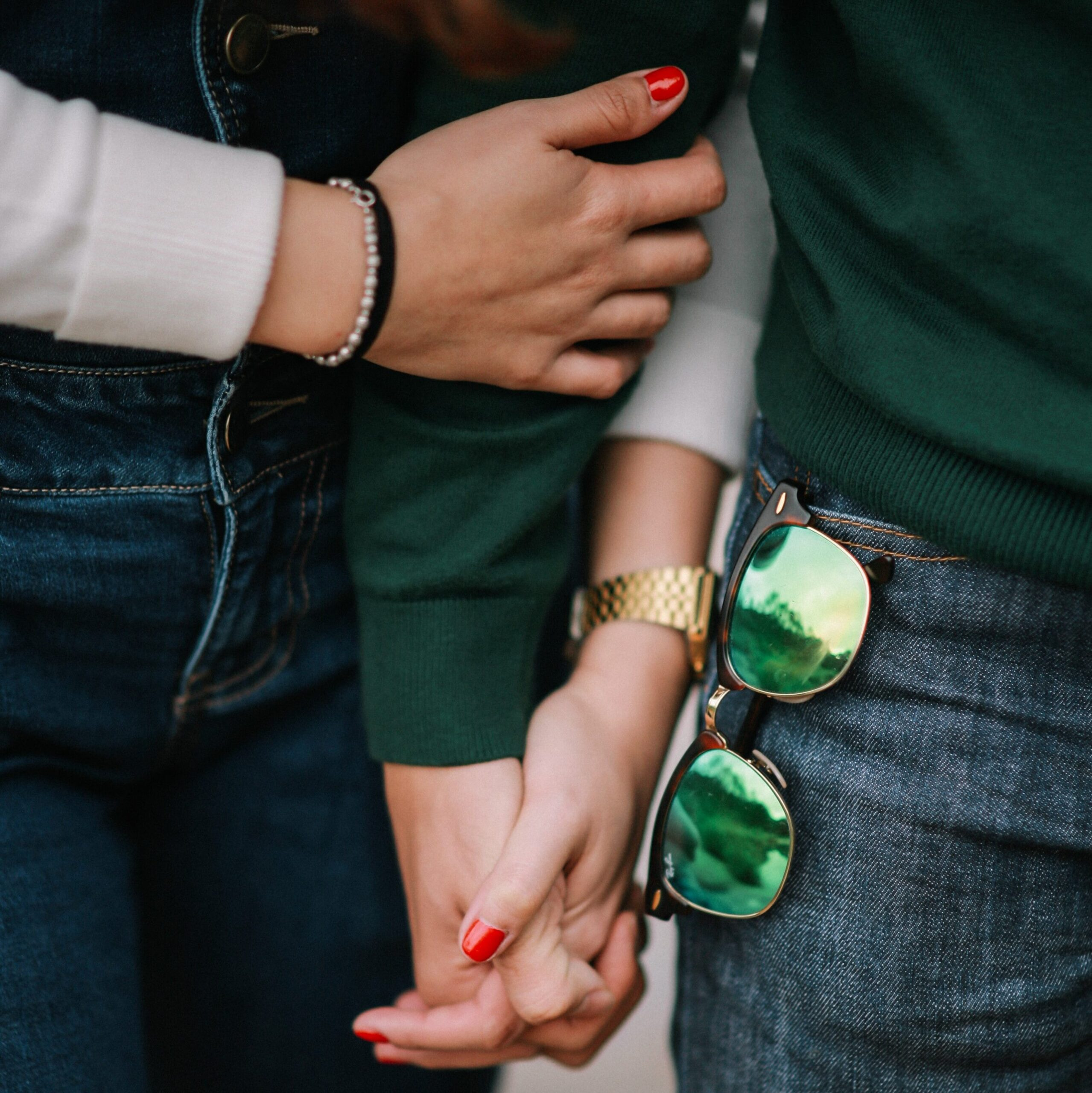 A couple holding hands.