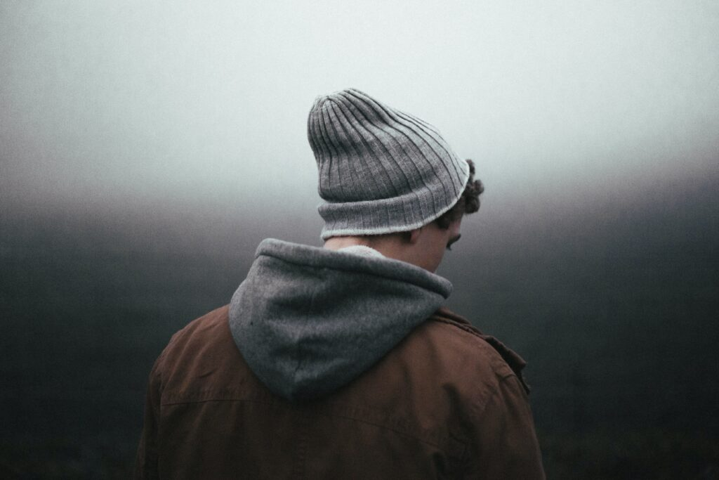 A person wearing a beanie, with their back facing the camera.