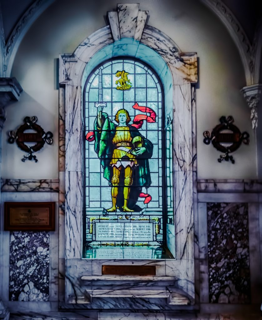 Stained glass window in Belfast City Hall, Ireland. A person holding a sword is pictured on the stained glass.