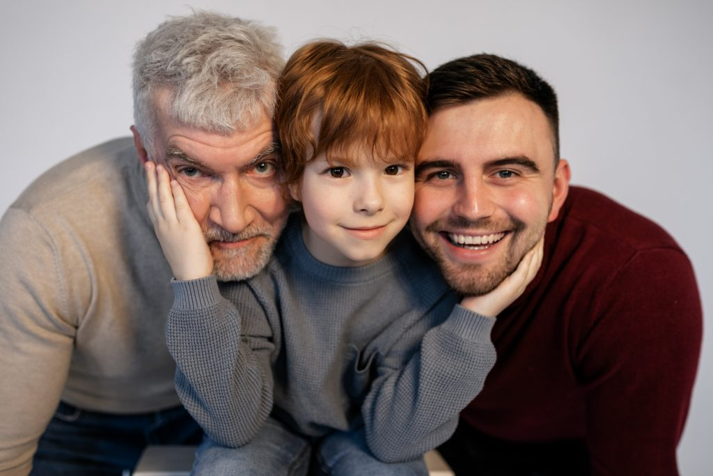 A child with his two fathers.
