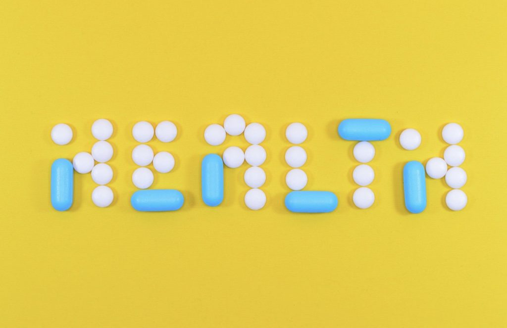 health spelled out with pills