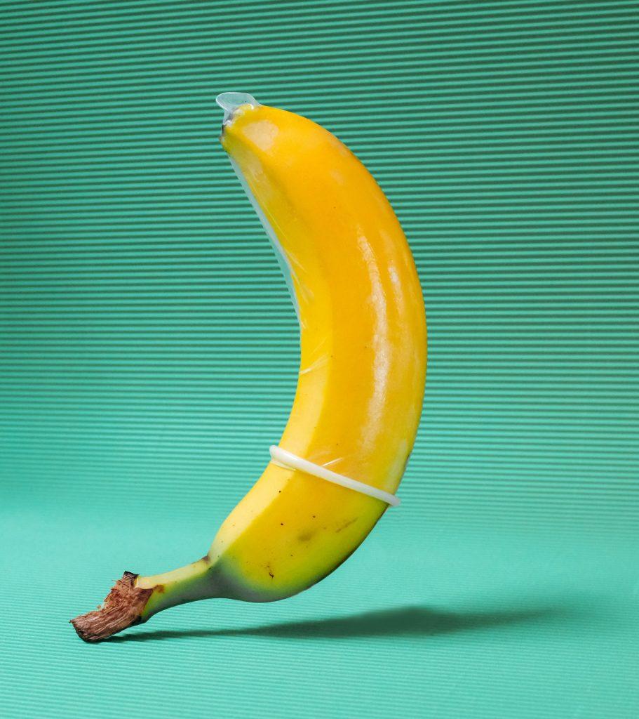 A banana wearing a condom.
