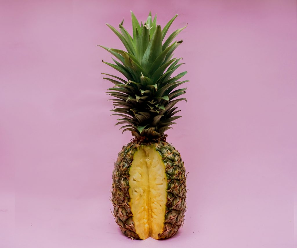 A partially cut pineapple.