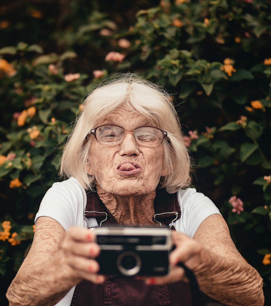 An older woman sticking out her tounge.