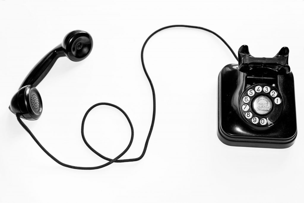 A black wired telephone.