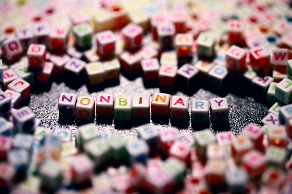 """""""NONBINARY"""" spelled out with colorful beads."""